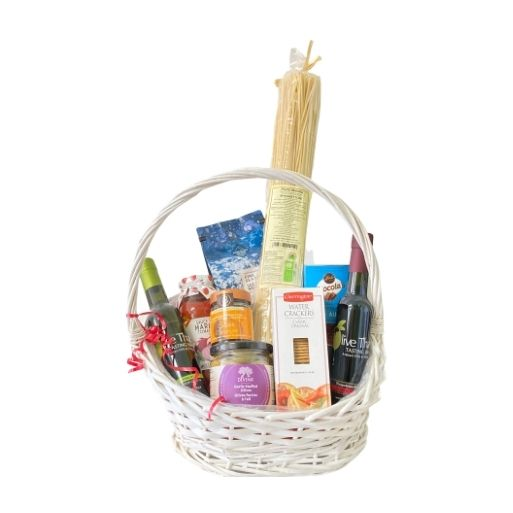 Valentine's Day gift basket with spaghetti, sauce, oil and vinegar, sea salt, olives, caramalized onion, crackers, and chocolate milk crisps.